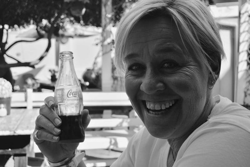 Anita in Hermanus in CT with coke bottle in hand