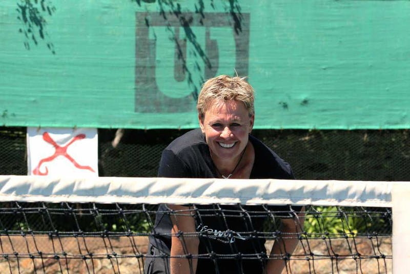 Anita looking over the net at the camera.