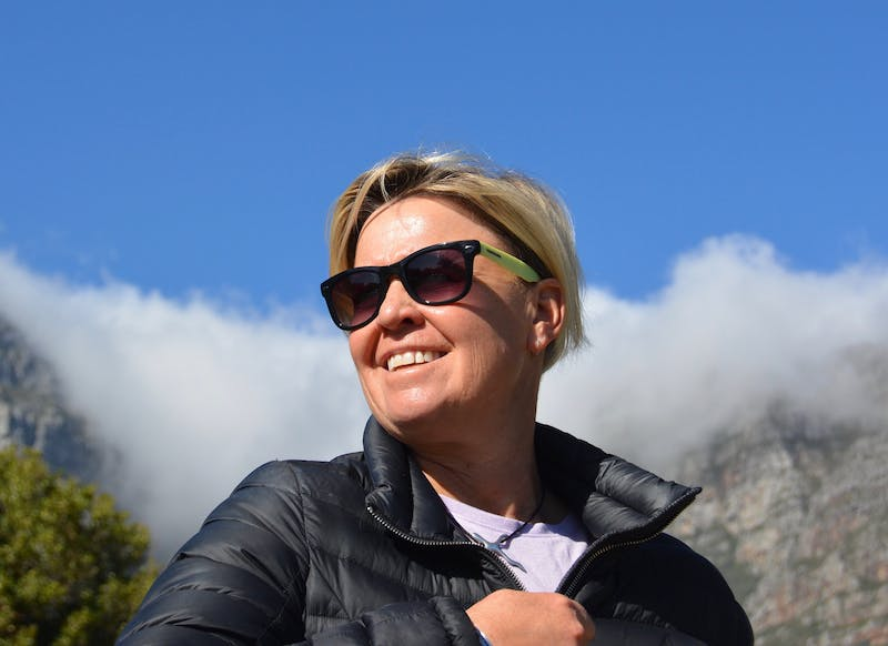 Anita with sunglasses. Table mountain in the background.