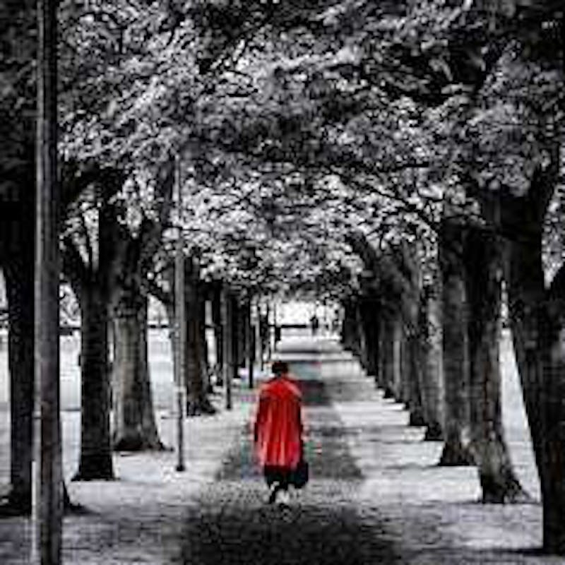 Anna walking down path with red coat on.