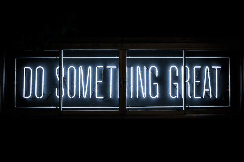 "A neon sign that says, ""do something great""."