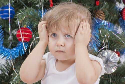 Festive disappointed little girl.