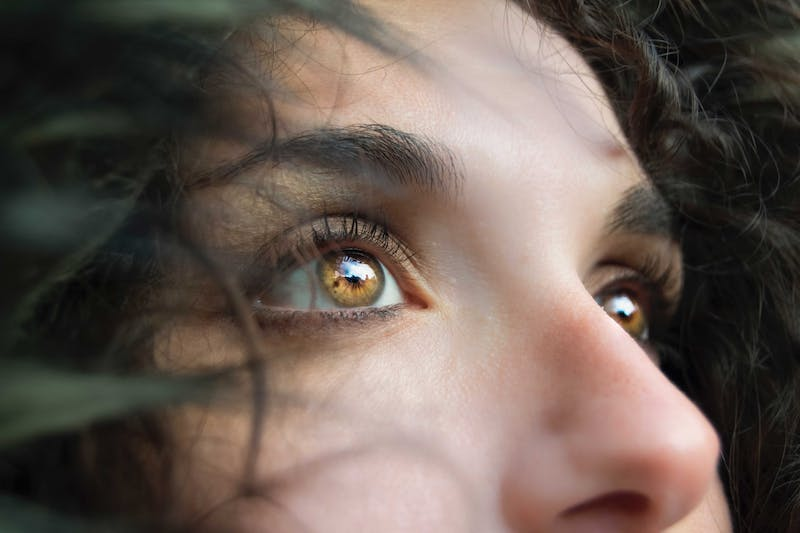 Close up on girl with beautiful brown eyes.