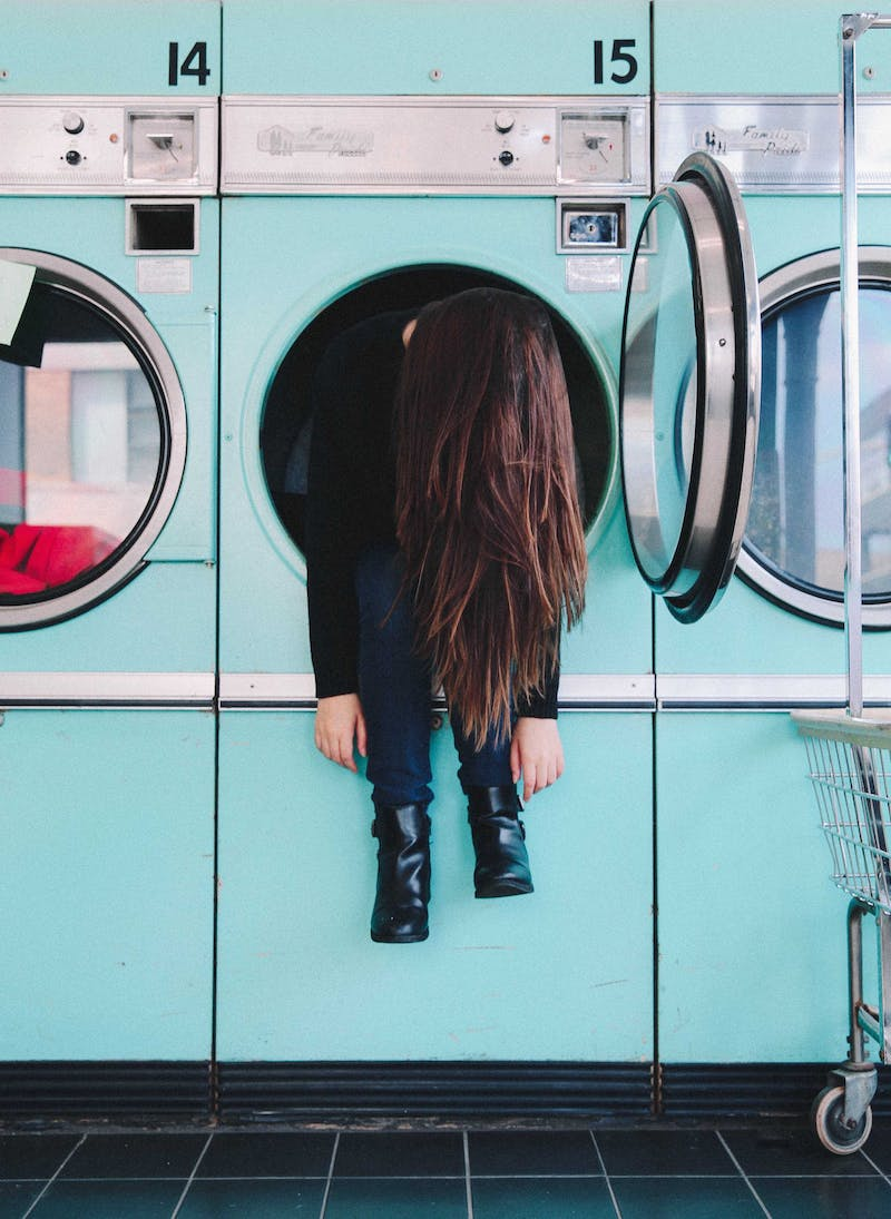 Girl in washing machine.
