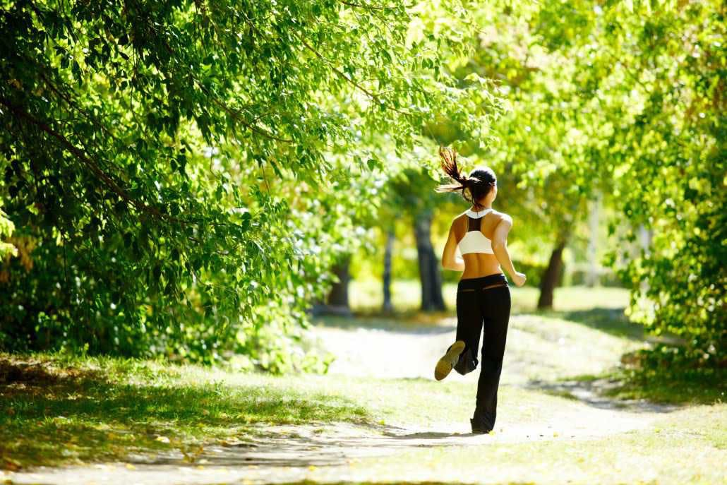 Girl running in a park.
