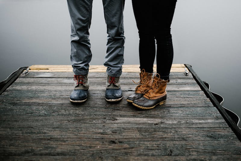 Two people on jetty - legs only.
