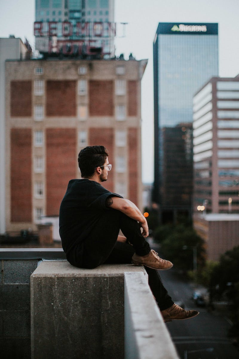 Guy looking out over roof tops