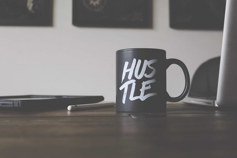 This is a pic of a mug that says hustle