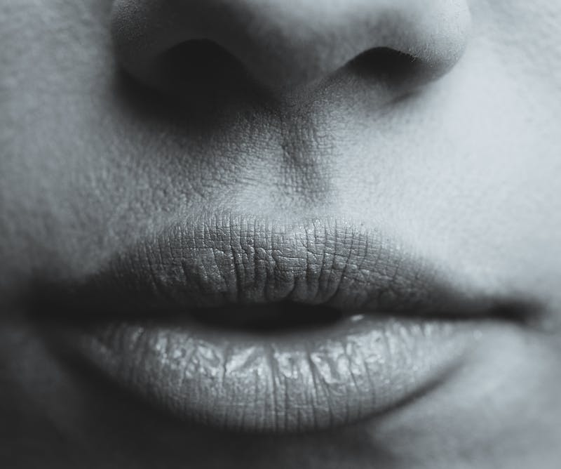 A woman's lips in black and white.