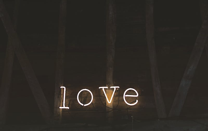 "A neon sign that reads ""love""."