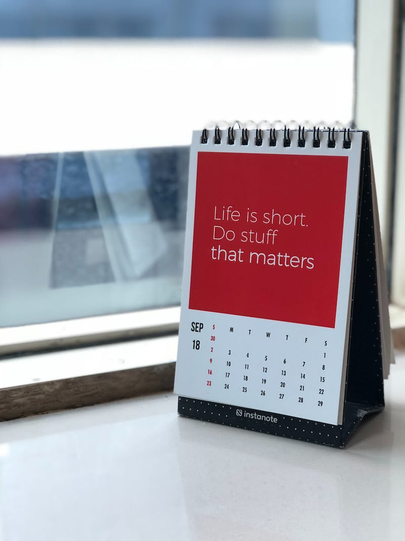 a calendar on a desk with a quote behind life is short do things that matter