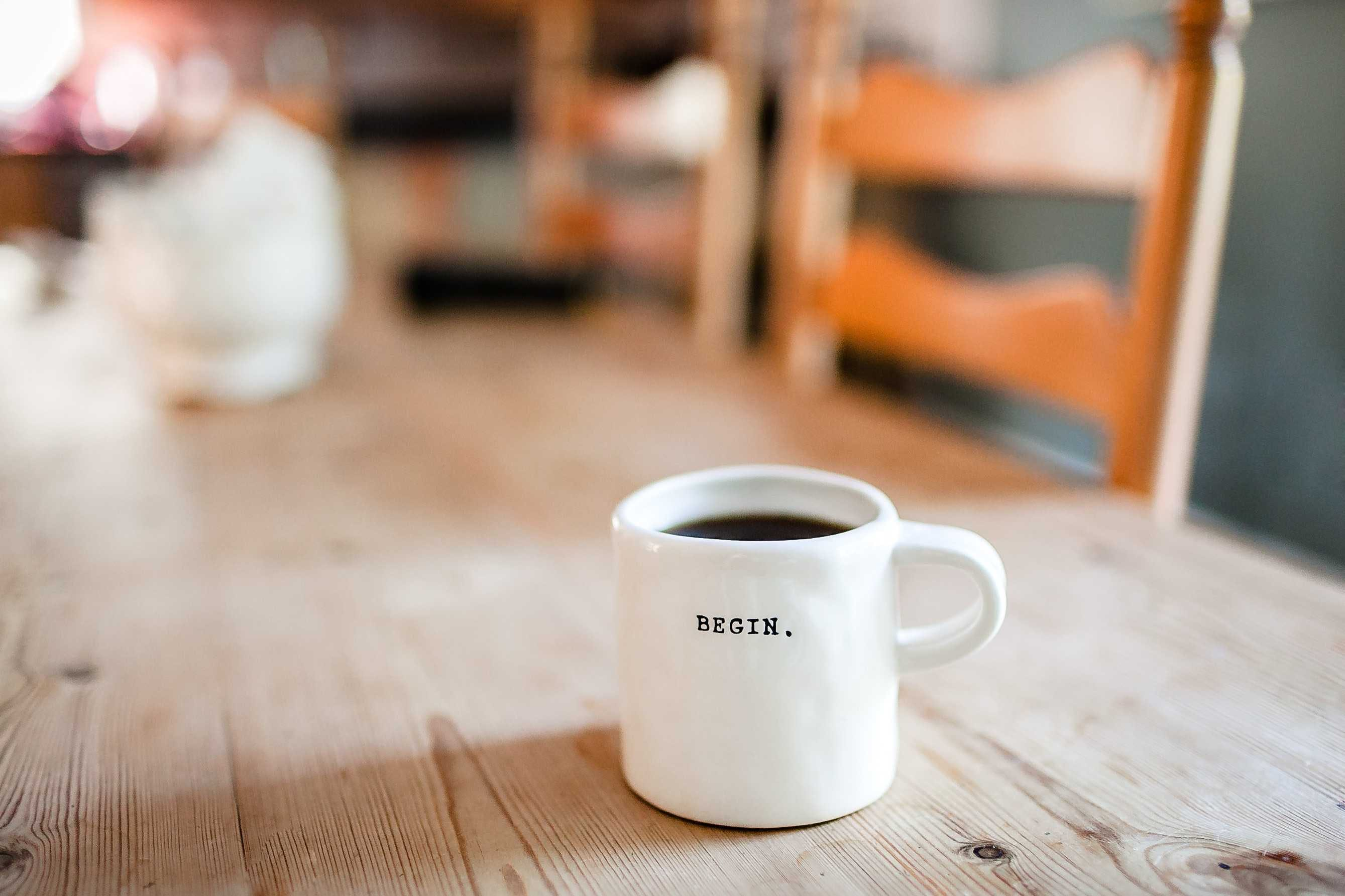 """A mug with the words """"Begin."""" written on it."""