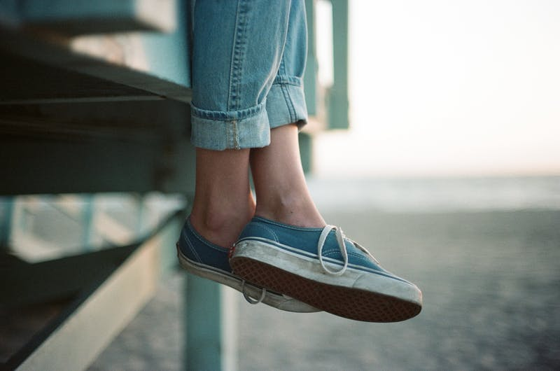 Photo focusing on someone's shoes.