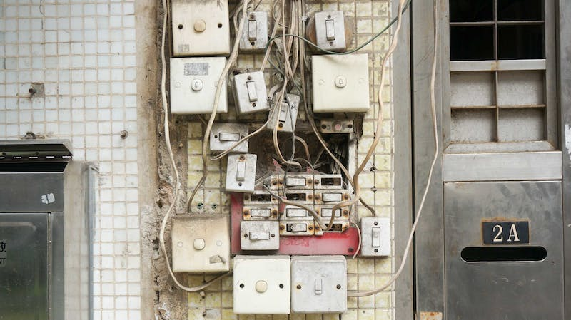 Many switches on a wall.