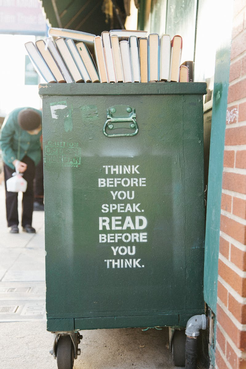 "Text on a big container of some sorts that reads, ""THINK BEFORE YOU SPEAK. READ BEFORE YOU THINK.""."