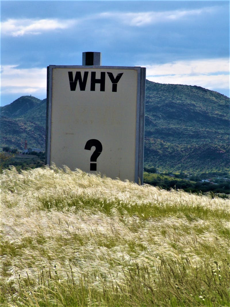 "A sign with the words ""WHY"" on. Taken in Namibia."