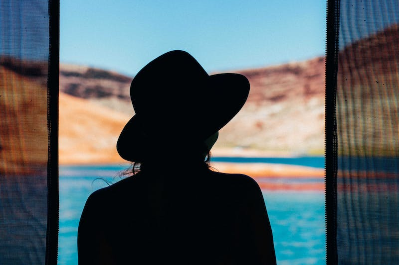 Woman looking out with a hat on
